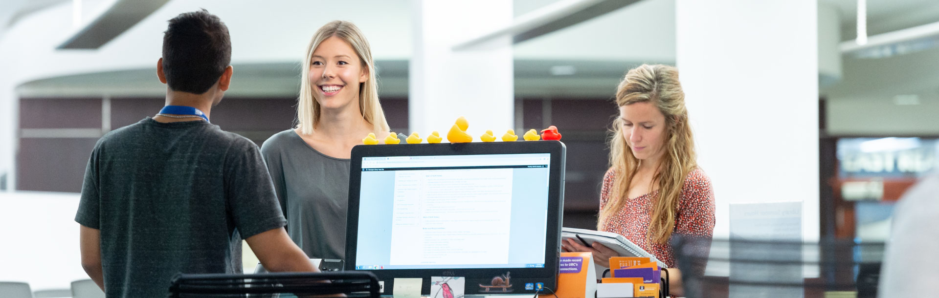 Students being helped at the Library Service Desk