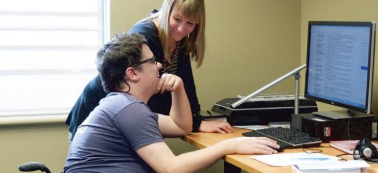 Librarian with student in the inclusive technology lab