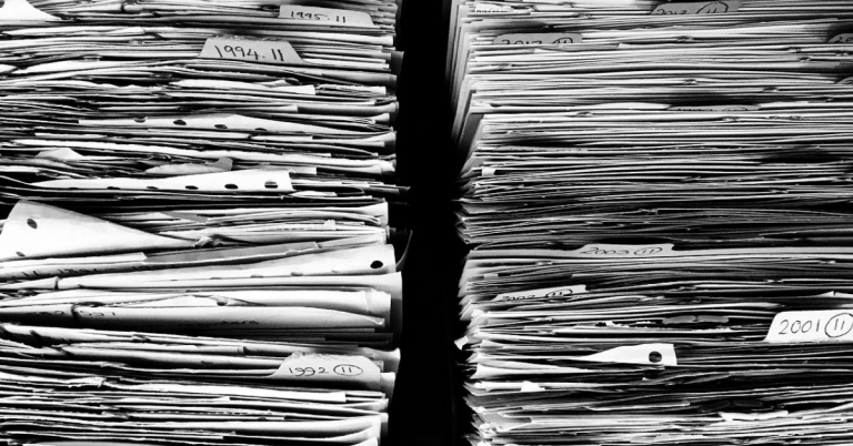 black and white stacks of paper records